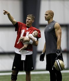 Little awkwardly positioned baby, you are making the exact face I would make if I were that close to Jimmy Graham's gun show.