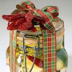 I+caprini+speziati+sott'olio+sono+un'idea+regalo+perfetta+per+chiunque.+Guarda+con+un+nastro+tartan+che+bella+confezione+ne+viene! Ingredienti 16+piccoli+formaggi+di+capra+semistagionati+ 4+foglie+di+