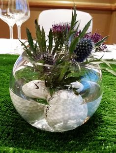 Scotland the home of golf! A beautiful table centre with a Scottish Thistle and golf balls supplied by Ada at the Flowerhouse.
