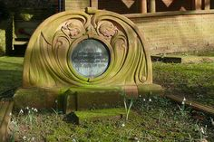 Inscription:  Sacred to the memory of Julian Russell Sturgis born October 21st 1848 died April 13th 1904.    PEVSNER: Buildings of England, Surrey (1971) pp.170    According to Pevsner this is the best Art Nouveau tombstone present.