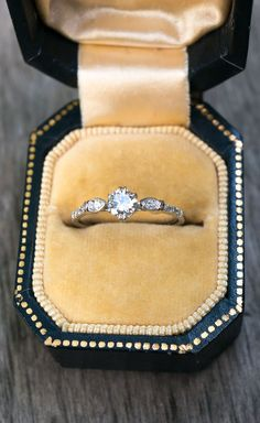 A vintage inspired Dainty Diamond Engagement Ring by S. Kind & Co. with an ethically sourced reclaimed diamond