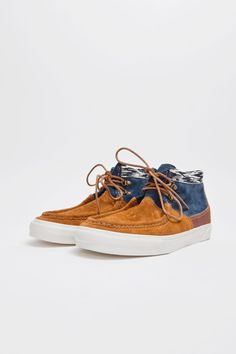acf4367439d47a Collaboration with artist Taka Hayashi. Mash-up style in Horween leather  and suede. Printed canvas on the ankle section. Four eye lacing system.