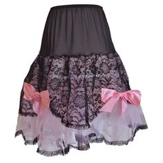 Unworn vintage 1950s petticoat in black nylon and lace with baby pink mesh and ribbon bows. Available at Candy Says Vintage Clothing, www.candysays.co.uk