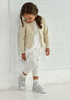 Striking a balance between modernity and romanticism is a new breath of the  Spring/Summer 2015 collection for girls from ELSY