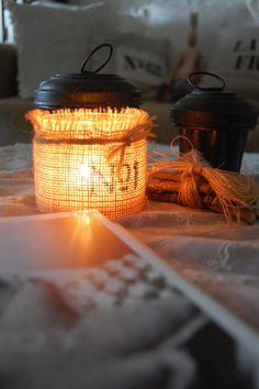 The jars were covered with burlap fabric, got letter and design and a simple hemp rope - super easy to make ...