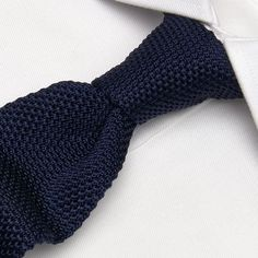Navy square end knitted silk tie - never been brave enough to wear one, maybe casual though...