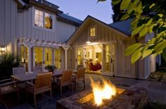 Great room opening out to patio and fire pit... love the lighting and the pergola, too.