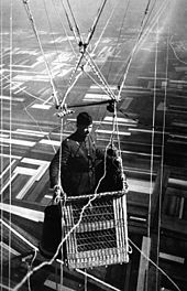 Close-up view of an American major in the basket of an observation balloon flying over territory near front lines