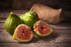 Old style still life with ripe fresh figs on wooden table. Stock Photo