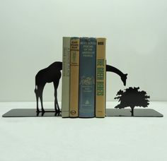 Giraffe Bookends by KnobCreekMetalArts This is truly wonderful, my book shelf feels naked without it...