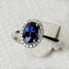 Engagement Ring  1.8 Carat Sapphire Ring With by stevejewelry, $1850.00 Not really my style, but it is very pretty!