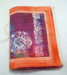 Collage Art Fabric and Recycled Paper Journal by TextileTraveler via Etsy.