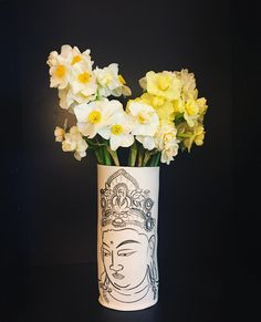 Farmer's market narcissus in one of my hand-built hand-painted porcelain vases.the need to find a space to do some ceramics is getting increasingly urgent. I may end up rolling out some porcelain on my kitchen counter. . . . . #porcelain #buddha #illustration #artlicensing