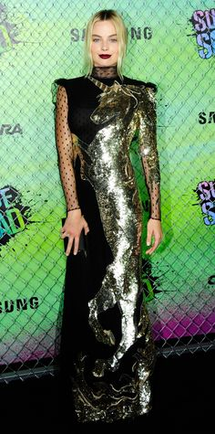 Margot Robbie achieved it all—elegance, glamour, whimsy—with her red carpet look at the world premiere of Suicide Squad. She wore a fantastic high-neck, long-sleeve Alexander McQueen creation that featured sheer point d'esprit sleeves and—wait for it—a sequined unicorn motif that ran the entire length of her gown.