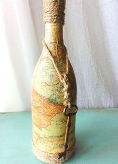 "Really like this ""down to earth"" design. So can do myself. Gift idea - use map of place a friend is going to on the bottle.  Hang a tiny envelope with trip ideas, a bit of cash, ??"