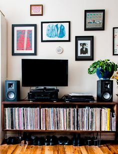 """""""For style inspiration, I centered my apartment around two pieces: my red coffee table (which I've had since my first apartment in San Francisco during college) and my record cabinet—built by a friend back in LA, Darren Crandell. I love how wood and deep reds go together, so I kept it as a theme throughout my place."""""""