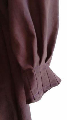 Pleated sleeve detail in organic cotton voile, lac dye. Botanica Tinctoria