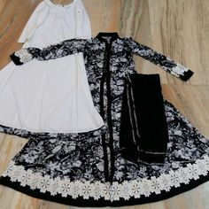 Typical black and white combination is one that is never out-dated. A beautiful black and white printed shirt with white palazzo having a bit of touch of shirt design made for customers.DM us at (call/WhatsApp) shipping worldwide. Baby Girl Dress Design, Fancy Dress Design, Simple Pakistani Dresses, Pakistani Dress Design, Stylish Dresses For Girls, Simple Dresses, Pakistani Fashion Party Wear, New Designer Dresses, Kurta Designs Women