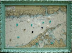Magnetic message board made from vintage nautical chart, with seaglass, pebble and sand dollar magnets by Mary McKey, www.freerangeguppies.com