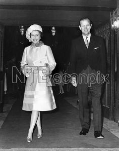 A smiling Queen Elizabeth II, accompanied by Prince Philip, Duke of Edinburgh leaves Westminster Abbey after a ceremony to mark their Silver Wedding Anniversary on 20th November 1972. Date: 1972