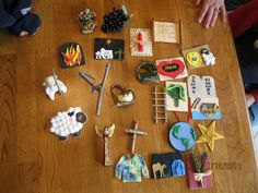 Jesse Tree ornaments - love the simple stick slingshot