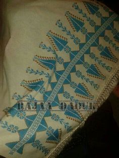 Cross stitched shawl