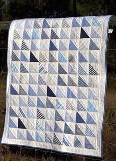 Blue and white half square triangle quilt