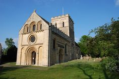 Iffley Church in Oxford, England. The rounded, concentric arches exhibit a style employed during the Romanesque period.