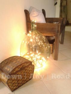 Lights inside an Italian demijohn add a beautiful holiday glow! Check out our store for great deals on hand picked demijohns here in Sicily! www.DownAnyRoad.com