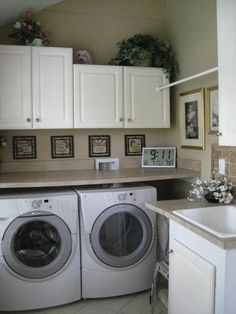 I'm really liking the shelf above the washer/dryer and cabinets above that idea