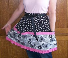 Pink and Black Ruffled Retro Half Apron by SusiesTieOneOnAprons.  This is a great gathering apron for eggs or veggies and would also make a cute vendor apron for your stall.