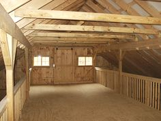 """Center Aisle Loft with 36"""" high guard rails. The center aisle hay loft provides more headroom inside of stalls and the ability to throw hay from loft into stalls without the use of hay drop doors."""