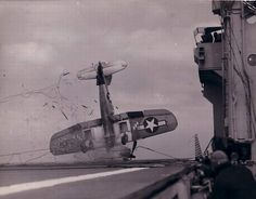 Vought F4U Corsair crashes on the deck of a carrier when the arresting gear failed...