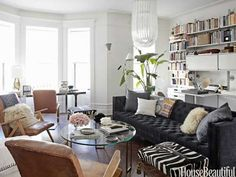 loving the extra long grey velvet sofa and the weathered leather chairs - Nate Berkus
