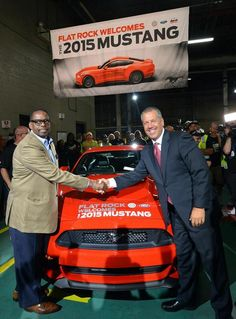 First  2015 Ford Mustang off assembly line handshake....love that I live right next to the city where they are born.  :)