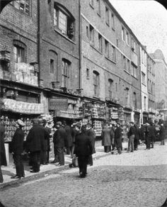 The Sunday morning live bird market in Sclater Street, off Brick Lane.  The famous Club Row Bird Fair, which extended into Sclater Street, was the most important bird market in London until the street-sale of live animals was banned in 1983.