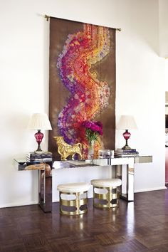 abstract art, mirrored console, brass stools, love the look!