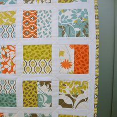 Modern baby quilt. love Love LOVE this layout. The white sashing makes it dance. Sew perfect for jelly rolls or charm packs. Using charm packs, pick two and lay them RST. Sew 1/4 seam only on the two vertical sides. Cut them in 1/2 parallel between the seams and you have an instant block! Do this with my layer cake??
