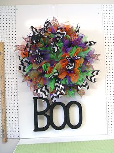 halloween-ruffle-wreath-boo-sign-hanging-from-bottom