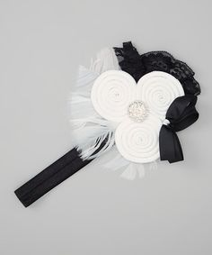 Take a look at this White Rolled Flower Headband by The Hair Candy Store on #zulily today! http://www.thehaircandystore.com