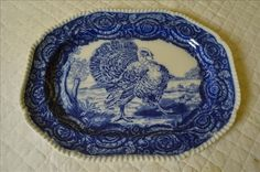 Offered is a large flow blue serving platter with turkey motif.
