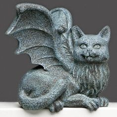 Cat Gargoyle Figurine makes the perfect Halloween decoration on your book shelf, computer, cubicle or presiding over the Halloween punch bowl at your party!