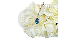 Beautiful White Roses  with expensive  pendant on the white background isolated.