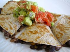 Black Bean Quesadillas :: tortillas, black beans, yellow onion, garlic, red bell pepper, frozen corn, cheese, avocado, tomato, chili powder, cumin, lime juice, salt, pepper, EVOO.