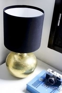 Recovering a drum lamp shade. I am doing this. I have a similar lamp only the base is silver. Gonna spray paint it gold and recover the shade.  http://www.nimidesign.com/category/diy/