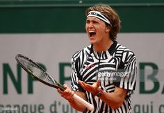 Alexander Zverev of Germany reacts during the Men's Singles third round match against Dominic Thiem of Austria on day seven of the 2016 French Open at Roland Garros on May 28, 2016 in Paris, France.