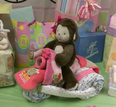 Monkey girl baby shower tricycle diaper cake
