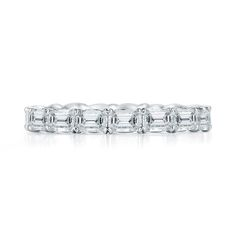 kwiat , emerald cut end to end diamond band in platinum split prong setting