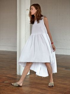 This cotton gauze dress features an open bodice with open fit skirt which…