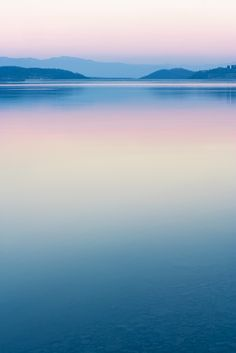 Peaceful ~ a great tranquil photo of a beautiful landscape -the colours' candy-like too; all too sweet.